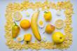 Постер, плакат: Картина из еды в желтом цвете на белом фоне