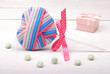 multi-colored heart with ribbon and mint candy.