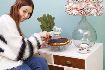 Beautiful redhead girl eating cheesecake handmade furniture