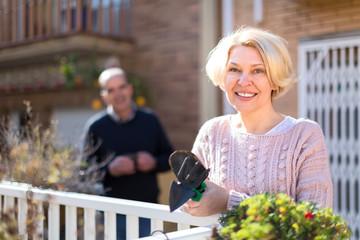 Senior woman gardening on terrace