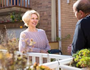 Mature couple talking on terrace