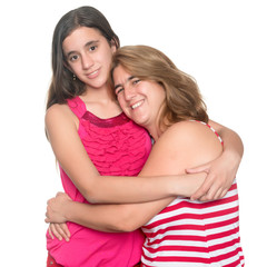 Hispanic teen girl hugging her mother and smiling