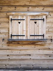 wooden shutters on a cabin window