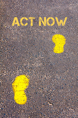 Yellow footsteps on sidewalk towards Act Now message