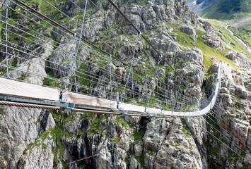Trift Bridge, pedestrian-only suspension bridge in Alps. Canton