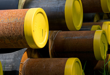 Construction tubes with yellow lids and rust.