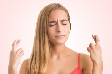 Woman Crossing Her Fingers For Good Luck