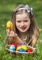 Child find easter egg outdoor.