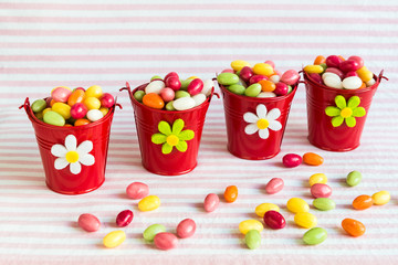 Colorful easter eggs in red buckets.