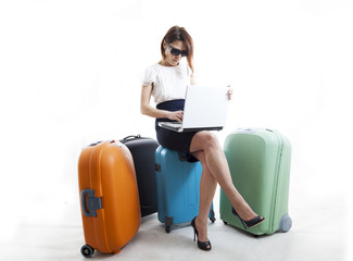 business woman with her suitcases ready to go