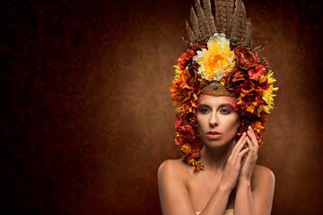 Beautiful woman in flowery headpiece