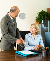Chief paying to elderly assistant an yearly bonus