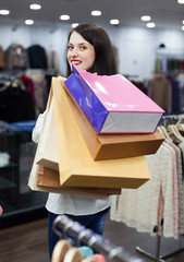 Ordinary girl with shopping bags