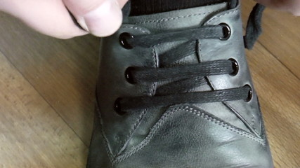 The video shows tying shoelaces