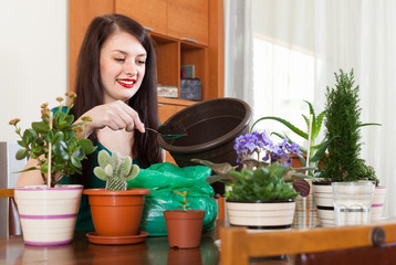 woman working with  flowers in pots