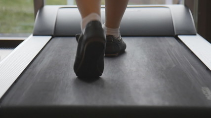 Legs running on a treadmill in slowmotion