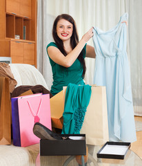 woman with new blue dress at  home