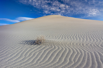 Snd dunes with ripples and clouds