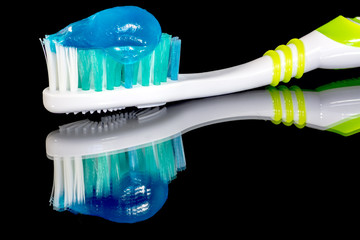 Toothpaste loaded on a brush ready to brush