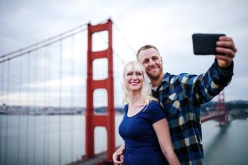 couple selfie by golden gate bridge with film grain filter