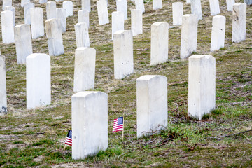 White tomb stones at a military cemetery