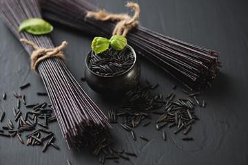 Close-up of raw black rice noodles, horizontal shot