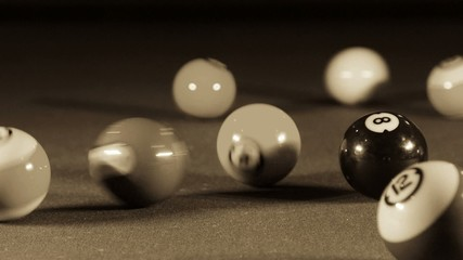 Playing billiard game on pool table
