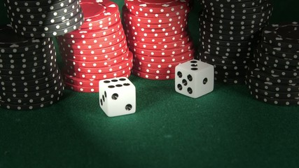 Rolling white dice on casino table - Gambling addiction concept