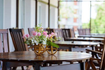 cafe on a sunny day with flowers on the table