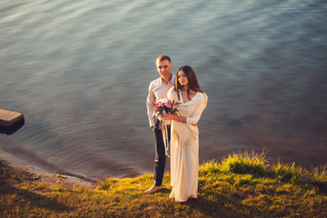 beautiful couple at sunset on the river