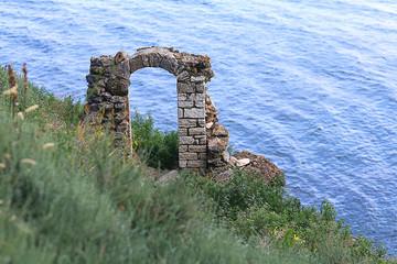 stone arch ancient ruins sea