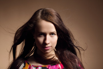 Fashion portrait of beautiful young girl