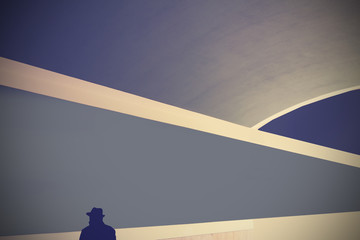 Retro abstract background with silhouette of a man in hat.