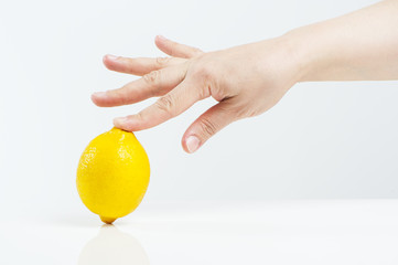 Lemon and a female hand..