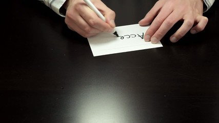 Hands draw the word Accept