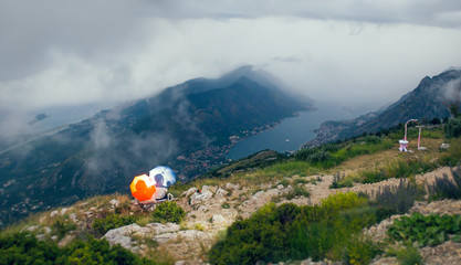 Couple under an umbrella enjoying the view of the Bay of Kotor