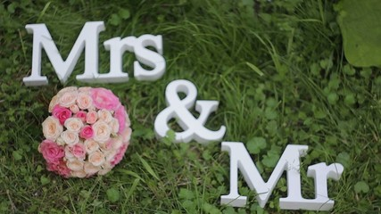 Mr. and Mrs. inscription with wedding bouquet
