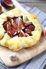 Pie with figs on a cutting board