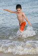 Child in water at beach