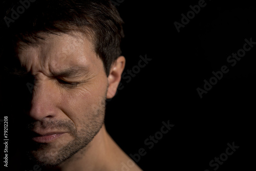 Distraught Man With Face In Shadow - 79212208