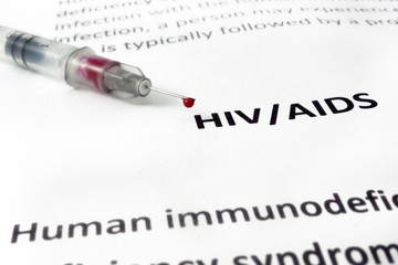 Paper with Hiv aids and syringe  with blood