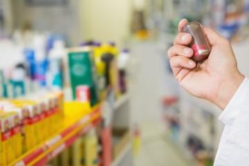 Pharmacist holding jar of medicine