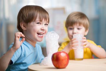 children drinking milk at home