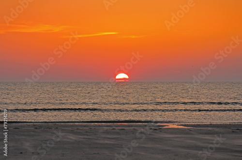 Leinwanddruck Bild Sonnenuntergang am Meer