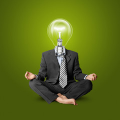 lamp-head businessman in lotus pose