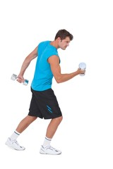 Fit man lifting heavy dumbbells