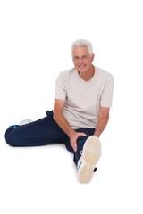 Senior man stretching his leg