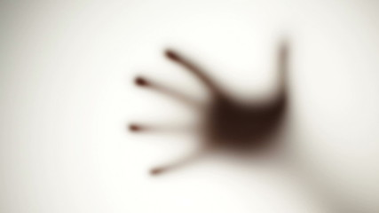 Spooky defocused hand - behind frosted glass