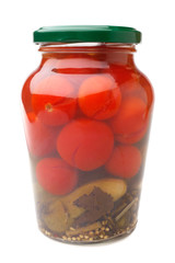 Tomatoes and cucumbers canned in glass jar