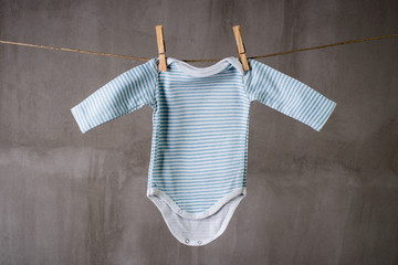 Baby Ringer T shirt   hanging on a clothesline